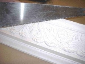 Cornice Being Cut with a Saw
